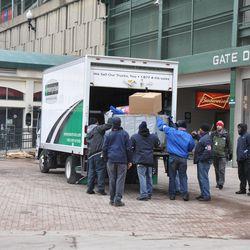 Ballpark workers unloading a truck at Gate D -