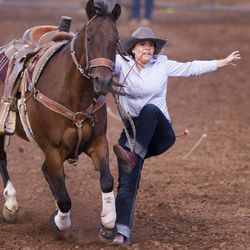 Erryn Hodson jumps off her horse to tie up a goat during the Utah High School Rodeo Finals in Heber City on Saturday, June 3, 2017.