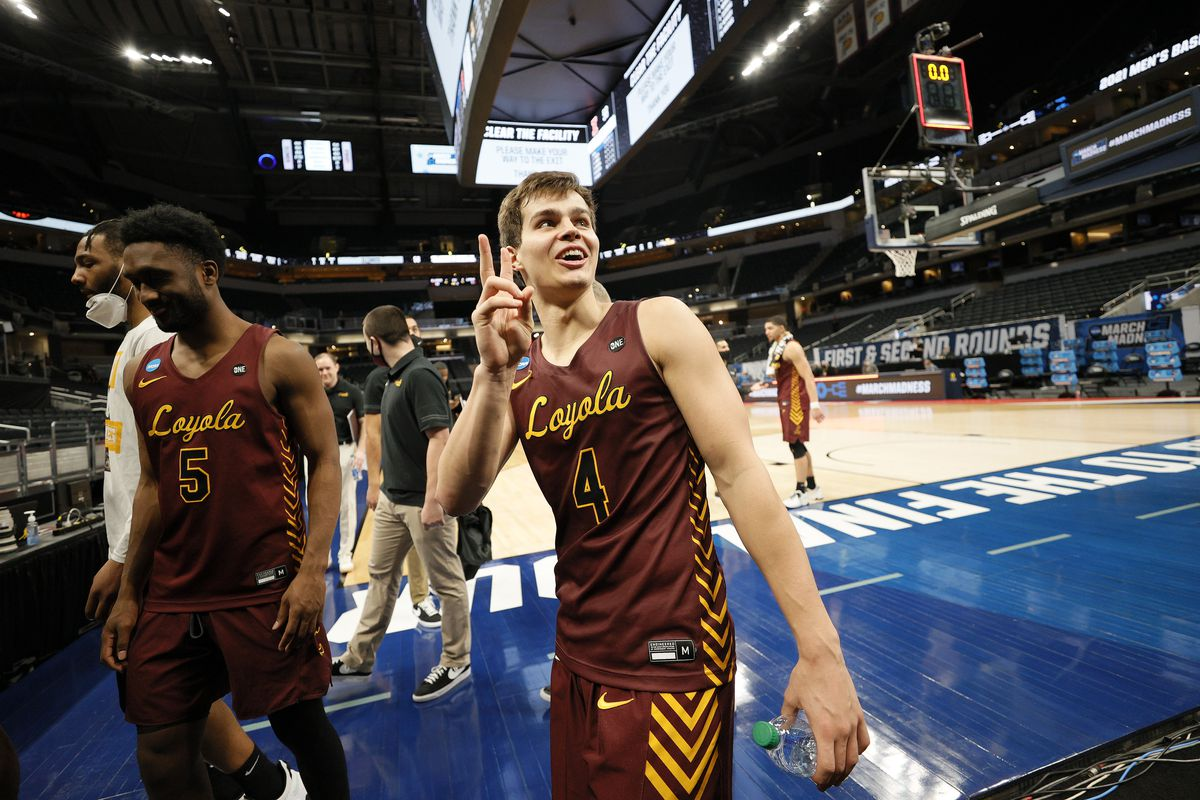 Braden Norris #4 of the Loyola Chicago Ramblers celebrates after defeating the Illinois Fighting Illini in the second round game of the 2021 NCAA Men's Basketball Tournament at Bankers Life Fieldhouse on March 21, 2021 in Indianapolis, Indiana.