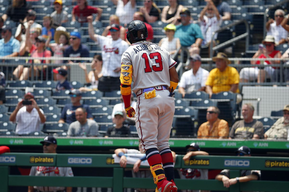Ronald Acuna Jr. #13 of the Atlanta Braves reacts after hitting a solo home run in the second inning against the Pittsburgh Pirates during the game at PNC Park on July 7, 2021 in Pittsburgh, Pennsylvania.