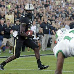 Purdue wide receiver Gary Bush scores a touchdown in front of Marshall linebacker Devin Arrington late in the fourth quarter of an NCAA college football game in West Lafayette, Ind., Saturday, Sept. 29, 2012. Purdue defeated Marshall 51-41.