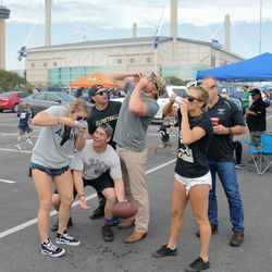 SAN ANTONIO, TX - NOVEMBER 12: Army Black Knights fans enjoying their tailgate in the Alamodome parking lot before the NCAA football game between the Army Black Knights and Notre Dame Fighting Irish on November 12, 2016 at the Alamodome, San Antonio, TX