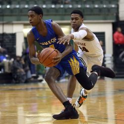 Simeon's Antonio Reeves (3) stays ahead of Morgan Park's Adam Miller (44) in their CPS semi final game at Chicago State University, Friday, February 15, 2019. | Kevin Tanaka/For the Sun Times