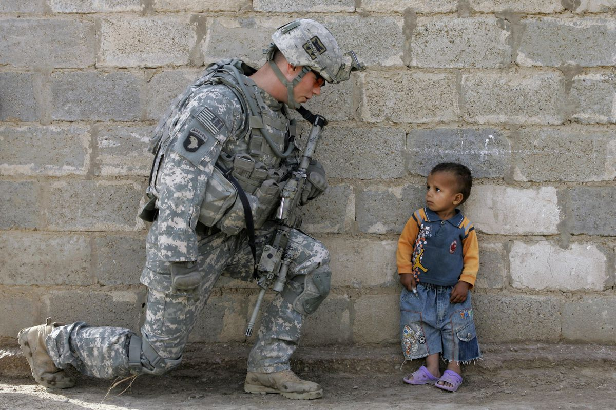 A US soldier with an Iraqi child in Baghdad, 2008. (Mauricio Lima/AFP/Getty  Images)