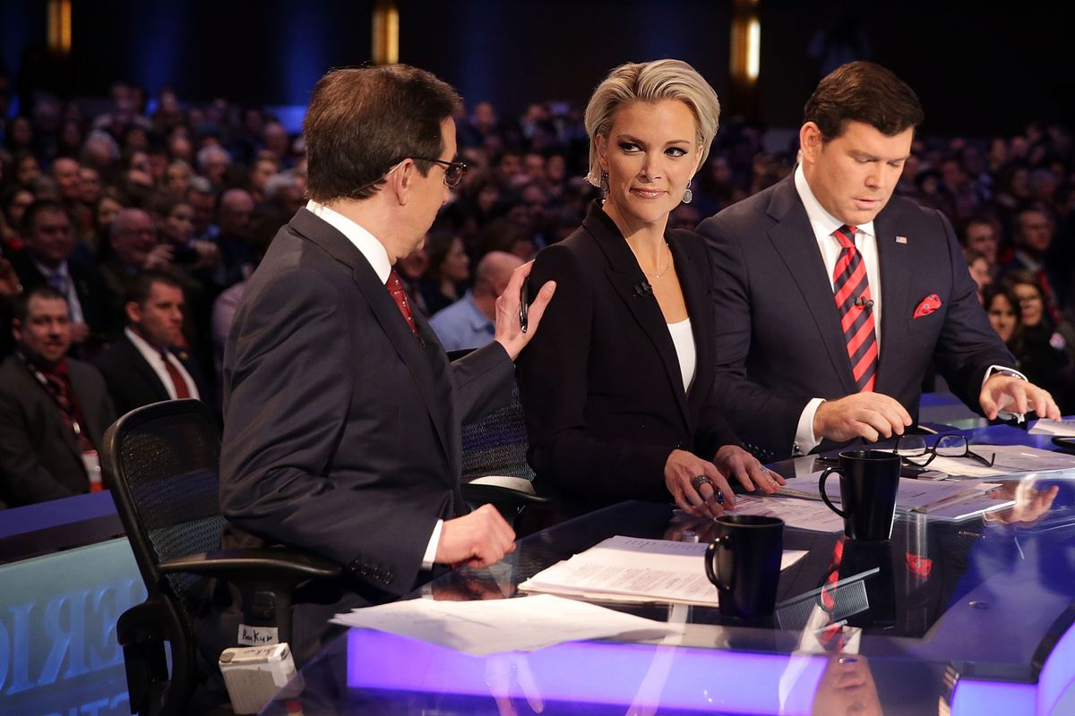 Fox News star Megyn Kelly with the network's Chris Wallace (left) and Bret Baier