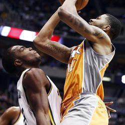 Phoenix Suns forward Markieff Morris, right, shoots over Utah Jazz forward Paul Millsap (24) during the first half of an NBA basketball game, Tuesday, April 24, 2012, in Salt Lake City. (AP Photo/Jim Urquhart)