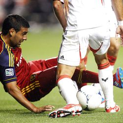 Javier Morales of Real Salt Lake fights to control the ball against Marcelo Saragosa of DC United during their MLS matchup at Rio Tinto Stadium in Sandy Saturday, September 1, 2012