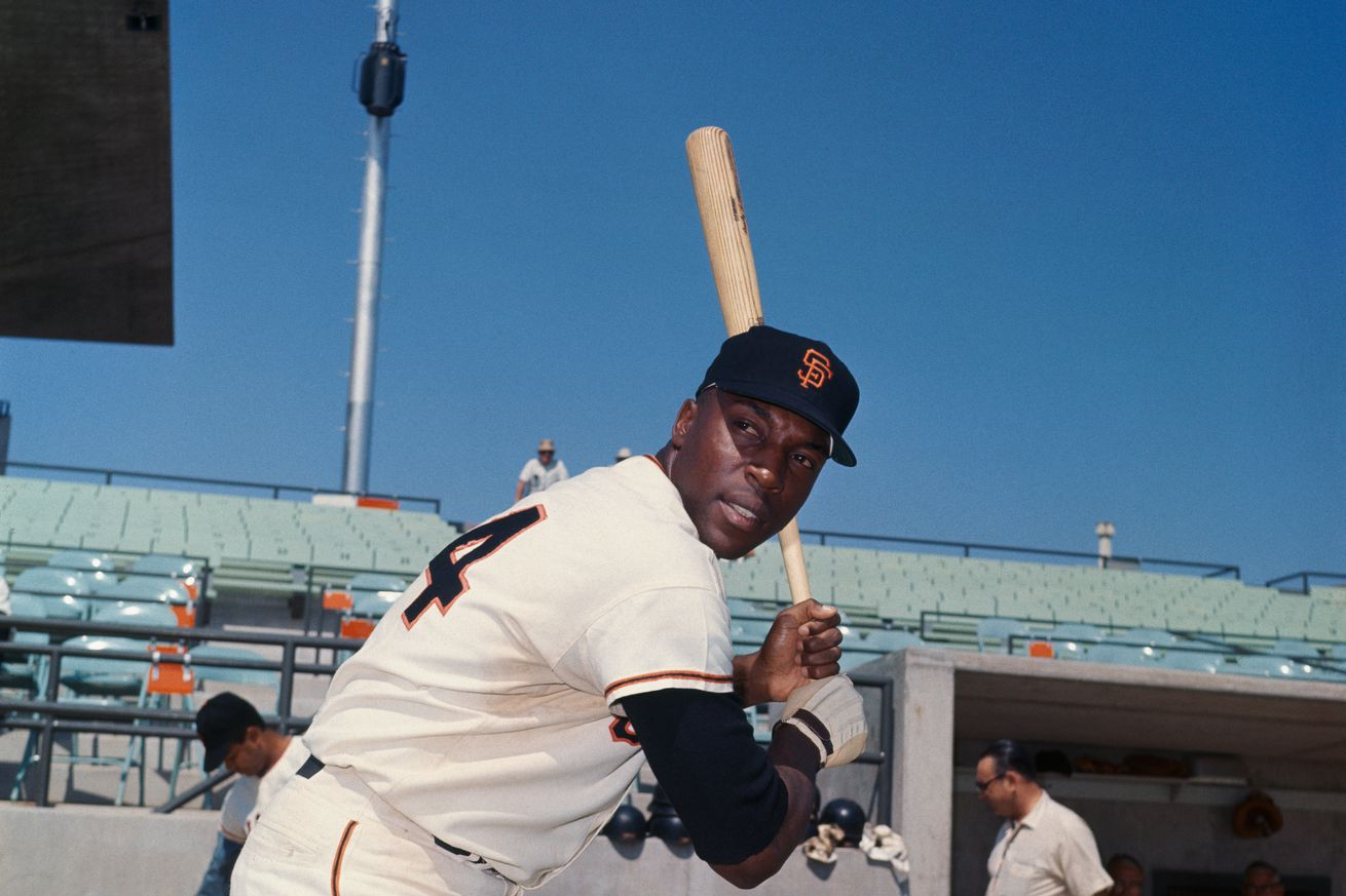Willie McCovey Holding a Baseball Bat