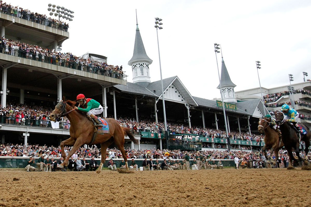 LOUISVILLE, KY - MAY 07:  Jockey John Velazquez, riding Animal Kingdom #16, leads the field across the finish line to win the 137th Kentucky Derby at Churchill Downs on May 7, 2011 in Louisville, Kentucky.  (Photo by Rob Carr/Getty Images)