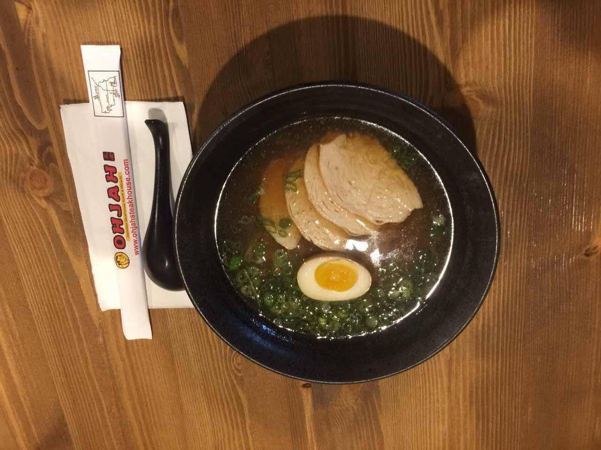 Bowl of noodles beside chopsticks