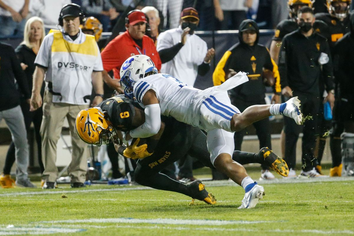 Arizona State wide receiver LV Bunkley-Shelton (6) gets tackled by BYU defensive back Chaz Ah You in Provo on Sept. 18, 2021.