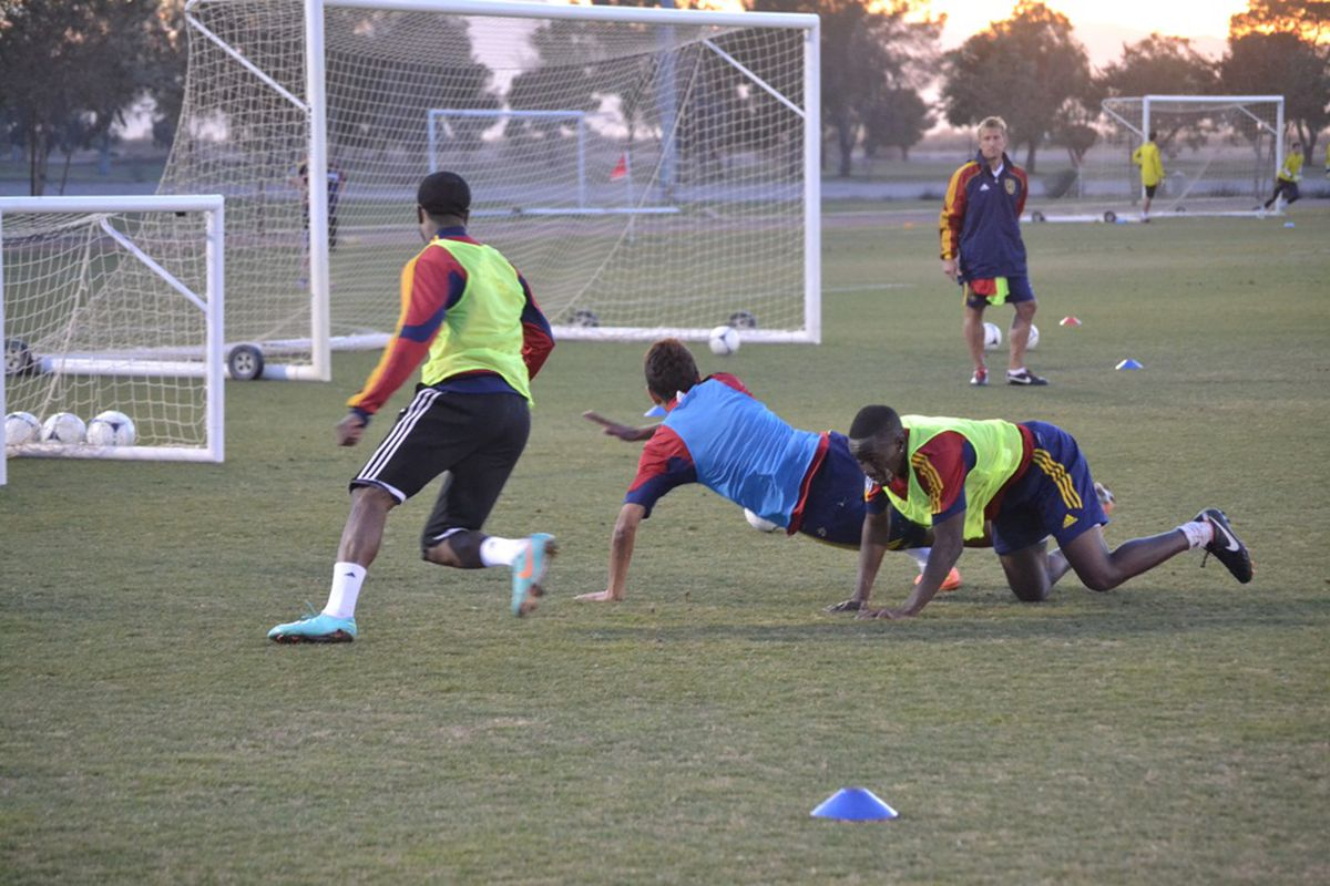Robbie Findley scores a goal in training past a couple of academy kids