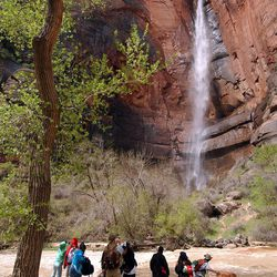 Hikers take a break at Zion National Park, April 19, 2005. There has been debate on whether recreation areas and national parks in Utah should be opened and run by the state during the federal government shutdown.