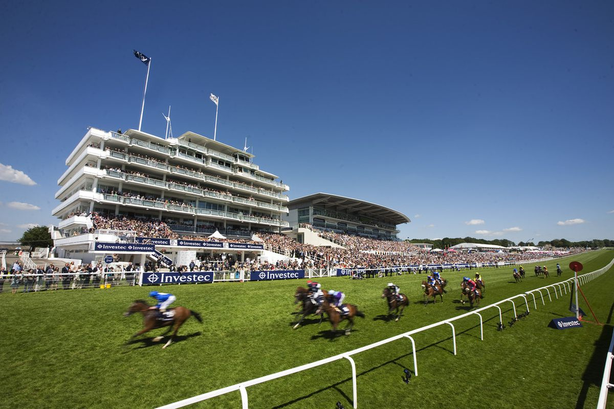 EPSOM, ENGLAND - JUNE 03: Ryan Moore riding Dance And Dance (L) ease down after winning The Investec Mile during The Derby Festival at Epsom racecourse on June 03, 2011 in Epsom, England  (Photo by Alan Crowhurst/ Getty Images)
