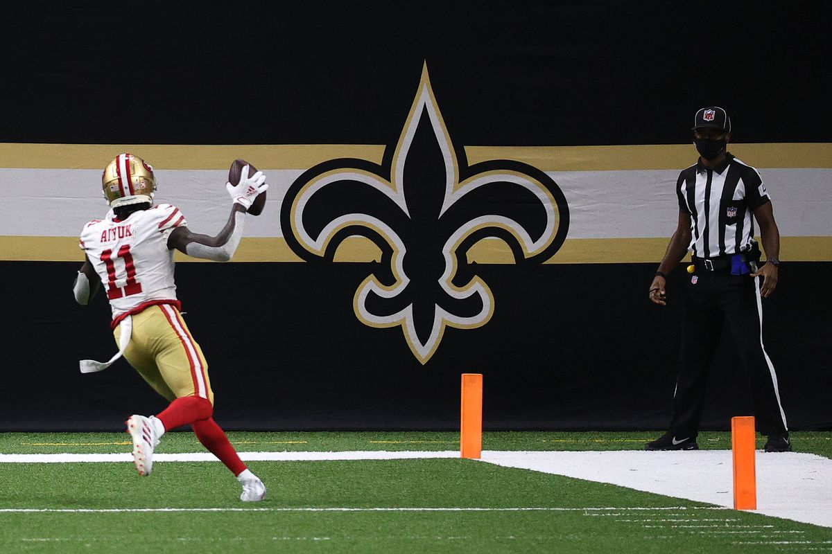 Brandon Aiyuk #11 of the San Francisco 49ers scores a touchdown during their game against the New Orleans Saints at Mercedes-Benz Superdome on November 15, 2020 in New Orleans, Louisiana.