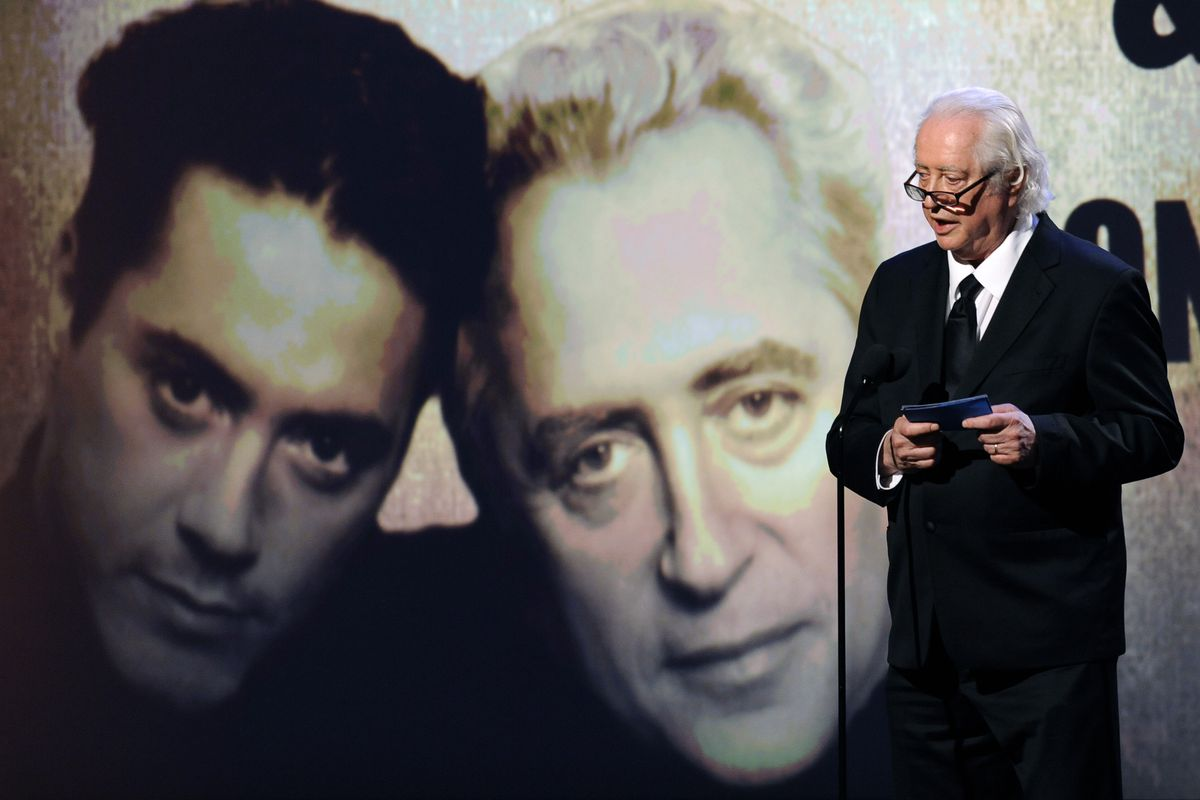 Actor and filmmaker Robert Downey Sr. addresses the audience with his son, actor Robert Downey Jr.