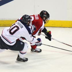 UConn's Miles Gendron (10) tries to keep Northeastern's Brendan Collier (16) from getting to the net.