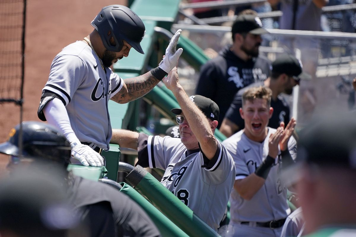 The White Sox' Leury Garcia, left, is greeted by coach Jerry Narron after hitting a home run off Pirates starting pitcher Chase De Jong during the second inning of Wednesday's game.