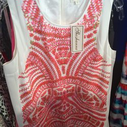White dress with coral sequin pattern, $85