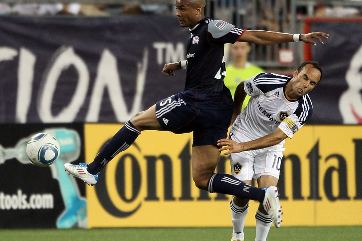 FOXBORO, MA - MAY 28:  Darrius Barnes #25 of the New England Revolution and Landon Donovan #10 of the Los Angeles Galaxy fight for the ball in the first half on May 28, 2011 at Gillette Stadium in Foxboro, Massachusetts  (Photo by Elsa/Getty Images)