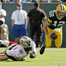San Francisco 49ers' Aldon Smith (99) sacks Green Bay Packers' Aaron Rodgers (12) during the first half of an NFL football game Sunday, Sept. 9, 2012, in Green Bay, Wis.