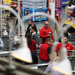 Customers move through the checkout area of the world's largest Costco, 1818 S. 300 West, in Salt Lake City on Friday, Oct. 30, 2015.