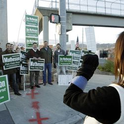 Jim Matheson and supporters get a photo taken after campaigning during a honk and wave at 13400 South and Bangerter Highway in Riverton on Friday, Nov. 2, 2012.