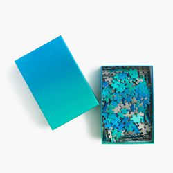 "Puzzle, <a href=""https://www.jcrew.com/gift-guide/GiftsUnder50/Womens/PRDOVR~E7884/E7884.jsp?color_name=blue"">$18</a> at J.Crew"