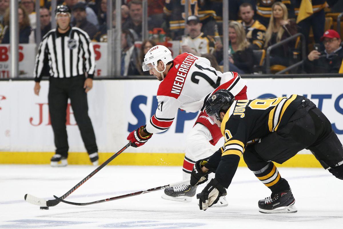 May 9, 2019; Boston, MA, USA; Carolina Hurricanes right wing Nino Niederreiter (21) skates with the puck as Boston Bruins left wing Marcus Johansson (90) defends during the third period in game one of the Eastern Conference Final of the 2019 Stanley Cup P