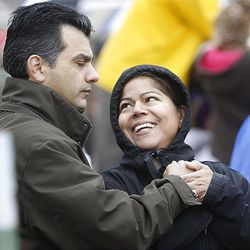 Mayro Gamez smiles up at her husband Julio during the ceremony as thousands turn out in the rain Saturday, Oct. 8, 2011 for the ground breaking for the Payson Temple.