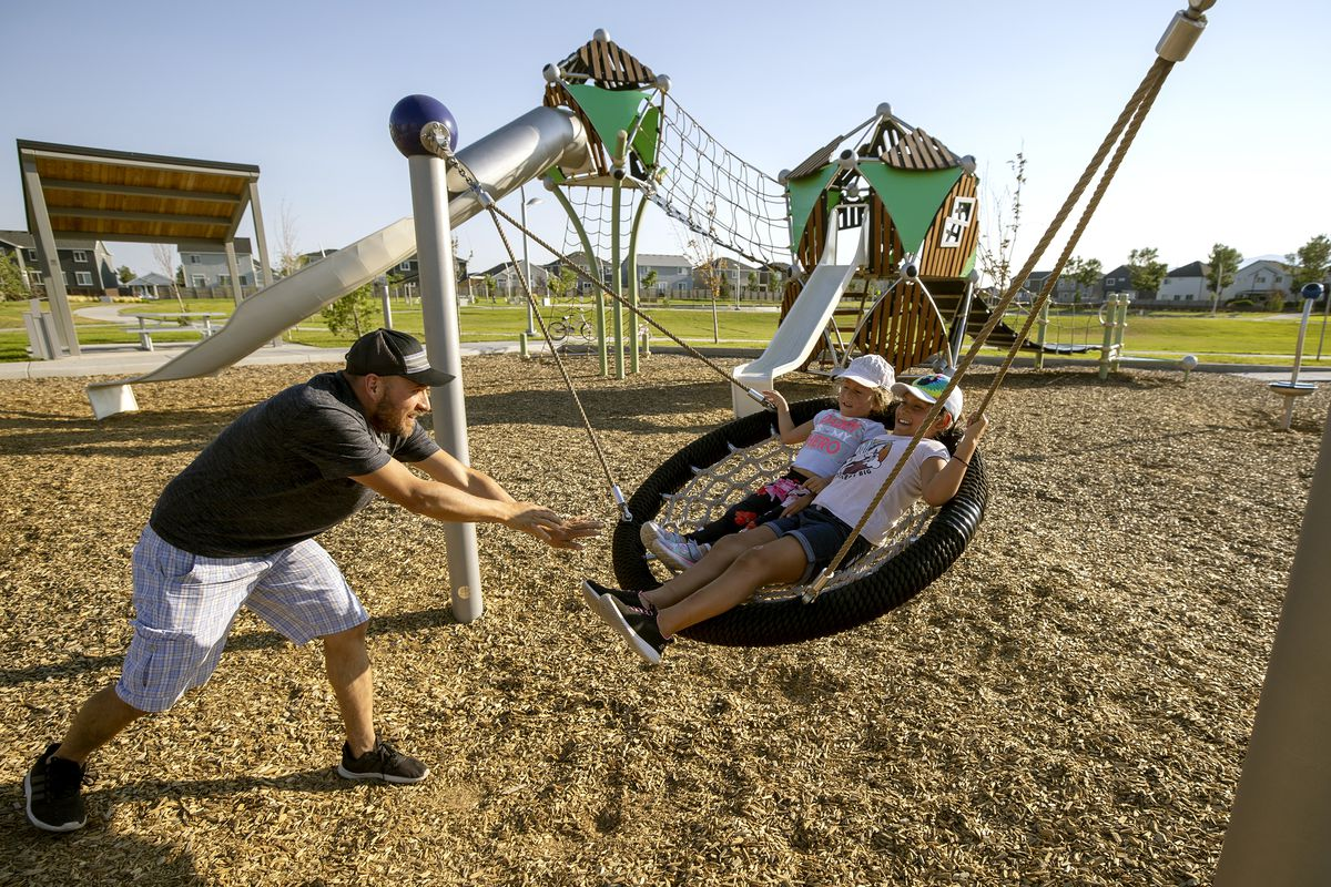 Braen Cublillos plays with his daughters Silvana Cubillos and Violeta Cubillos while at a park in Vineyard on Wednesday, Aug. 11, 2021.