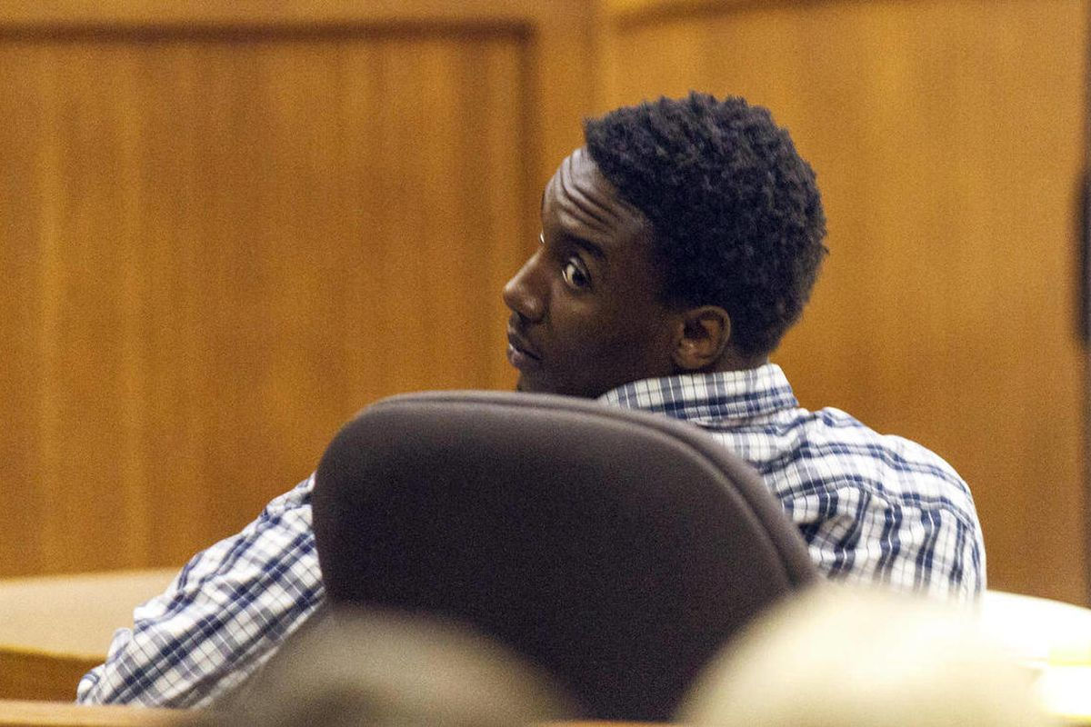 Former Auburn football player Antonio Goodwin glances back to his mother Renatta Goodwin as Auburn Police detective Jude Hackett discusses the confession he had just read that was given to him by Goodwin during Goodwin's robbery trial, at the Lee County J