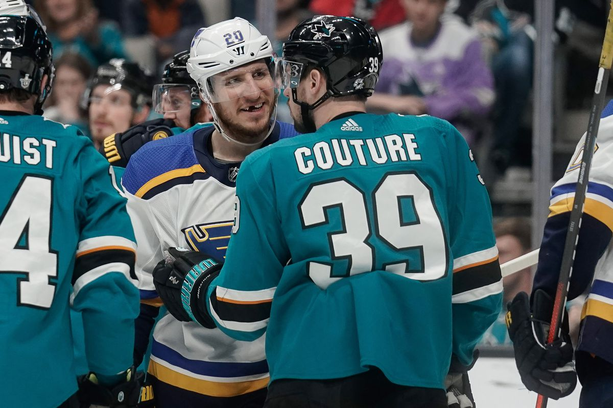 San Jose Sharks center Logan Couture (39) holds back St. Louis Blues left wing Alexander Steen (20) during the third period in Game 5 of the Western Conference Final of the 2019 Stanley Cup Playoffs at SAP Center at San Jose.