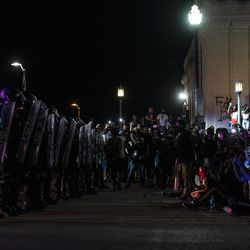 Protesters and police stand off with one another on Sheridan Road near Civic Center Park during a protest over the shooting of Jacob Blake, Tuesday, Aug. 25, 2020, in Kenosha, Wis.