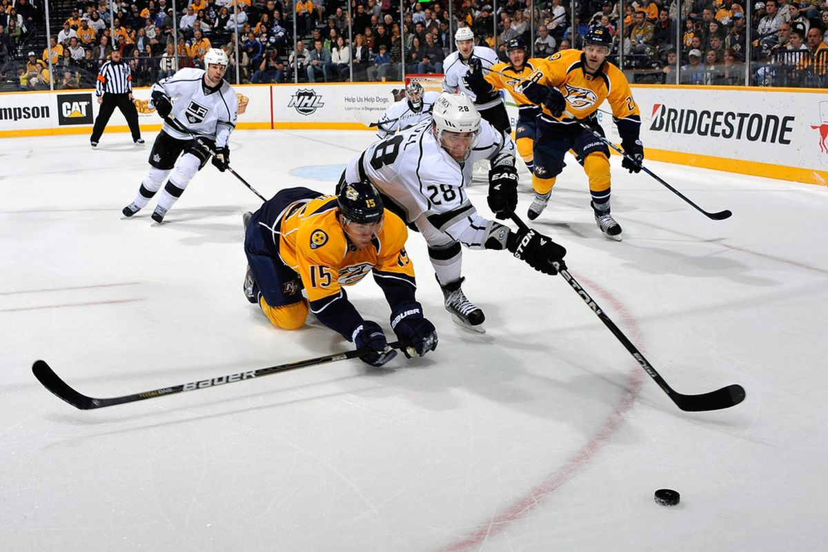 NASHVILLE, TN - MARCH 06:  Craig Smith #15 of the Nashville Predators dives for a puck in front of Jarret Stoll #28 of the Los Angeles Kings at the Bridgestone Arena on March 6, 2012 in Nashville, Tennessee.  (Photo by Frederick Breedon/Getty Images)
