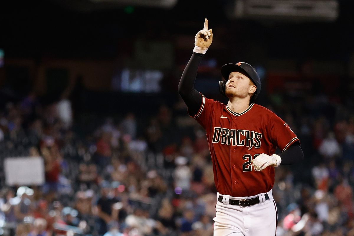 Pavin Smith of the Arizona Diamondbacks reacts after hitting a two-run home run against the Colorado Rockies during the fifth inning of the MLB game at Chase Field on May 02, 2021 in Phoenix, Arizona.
