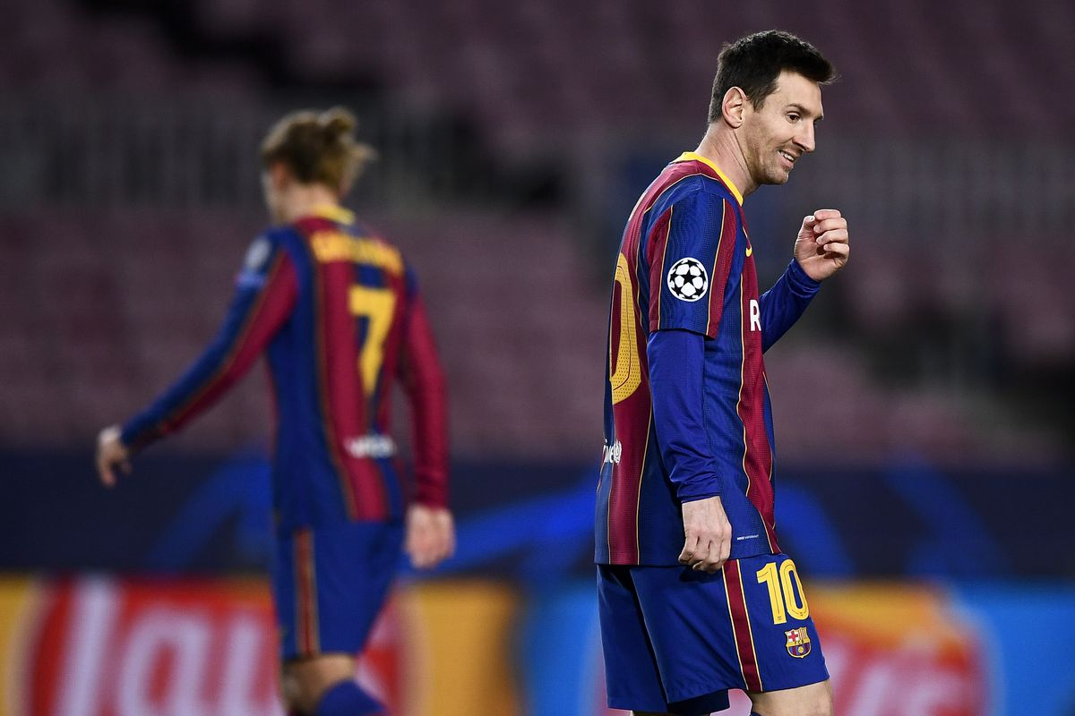 Lionel Messi (R) of FC Barcelona smiles during the UEFA...