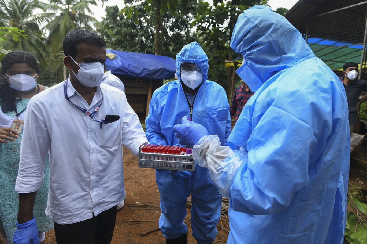 Health workers after a 12-year-old boy died of the Nipah virus in Kozhikode, Kerala state, India.
