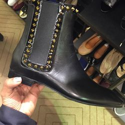 Christian Louboutin boots, $587.50