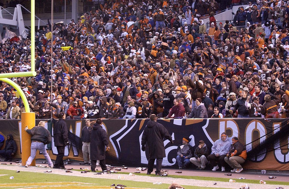 Security personnel move in front of the Dawg Pound