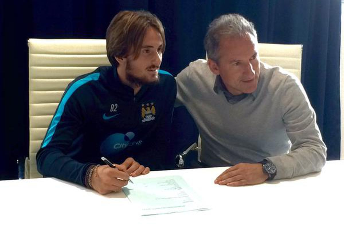 Aleix signs on the dotted line for Manchester City.  Good luck; we will miss you, hope you return sometime