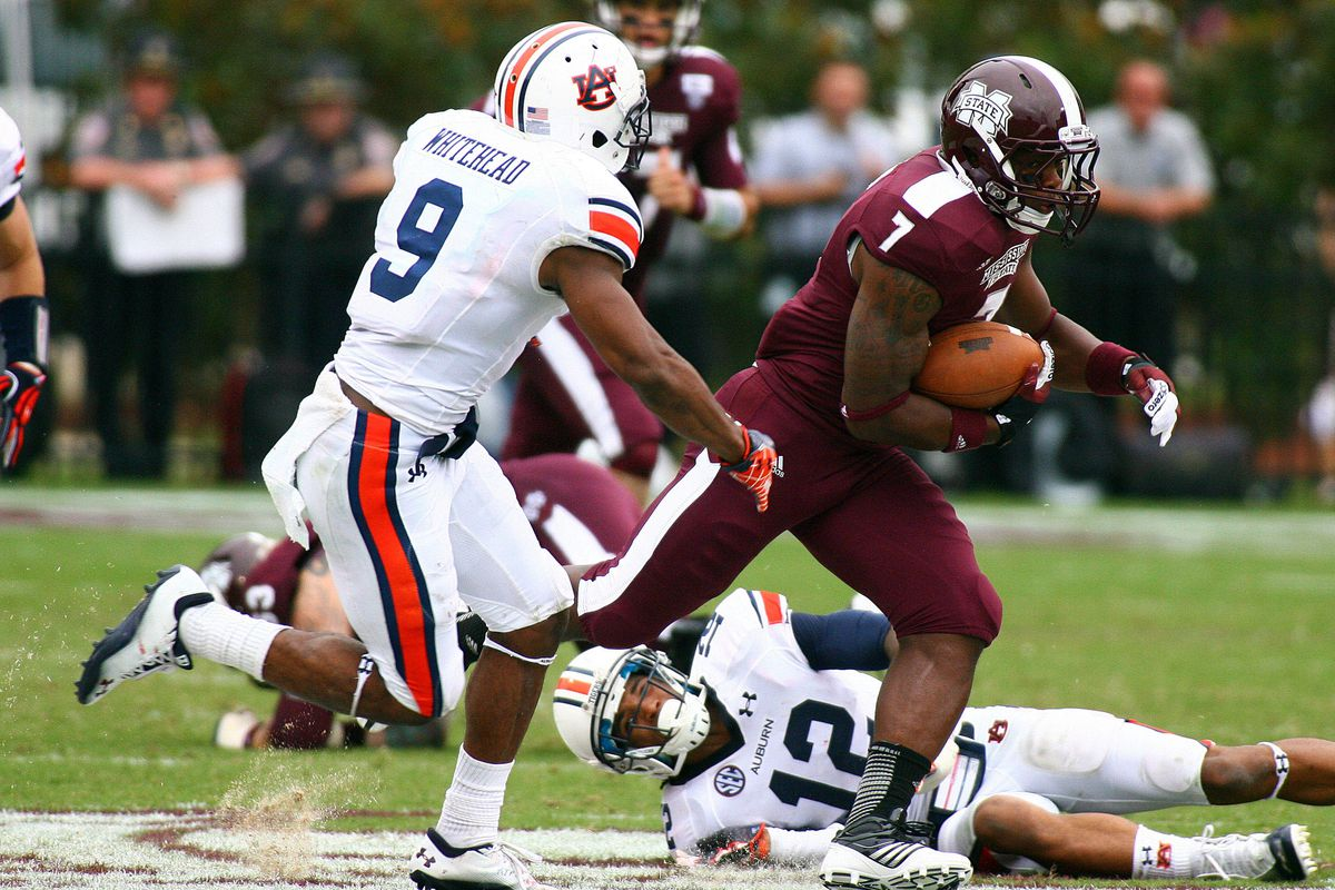 Mississippi State Bulldogs running back Nick Griffin (7) rushes for big yardage up the middle against the Auburn Tigers at Davis Wade Stadium.