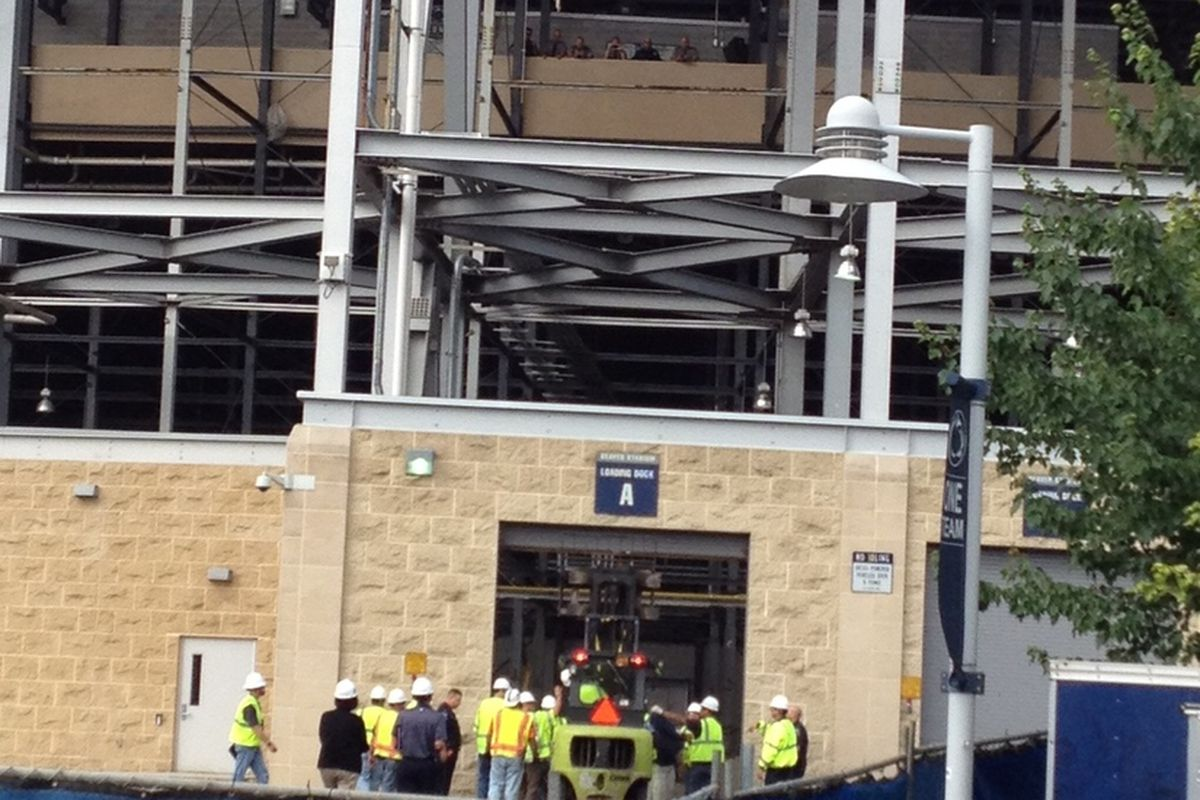 The Joe Paterno Statue being taken into Beaver Stadium by forklift on the morning on July 22, 2012. (Photo by Dan Vecellio)