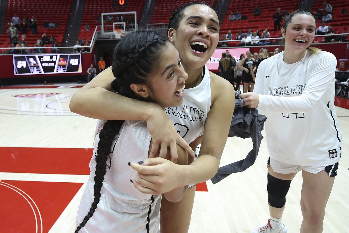 Highland's Kaija Glasker (22), center, celebrates the win over Mountain View with teammate Lei Makaui (2) during a 5A girls semifinal game at the Jon M. Huntsman Center in Salt Lake City on Thursday, Feb. 27, 2020. Highland won 54-45.
