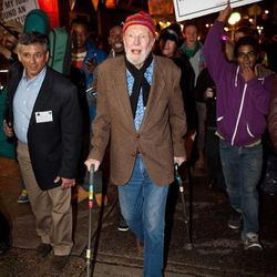 """Activist musician Pete Seeger, 92, center, marches with nearly a thousand demonstrators sympathetic to the Occupy Wall Street protests for a brief acoustic concert in Columbus Circle, Friday, Oct. 21, 2011, in New York. The demonstrators marched down Broadway singing """"This Little Light of Mine"""" and other folk and gospel songs while ad-libbing lines about corporate greed and social justice."""