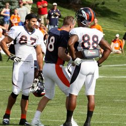 Broncos wide receivers Eric Decker (left) and Demaryius Thomas (right) watch quarterback Peyton Manning's new dance move.