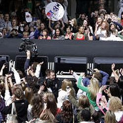 David Archuleta waves to a mob of fans from the roof of a limo as he leaves The Gateway Friday.
