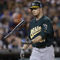 Oakland Athletics' Brandon Moss flips his bat after striking out to the Detroit Tigers in the eighth inning of a baseball game in Detroit, Wednesday, Sept. 19, 2012.
