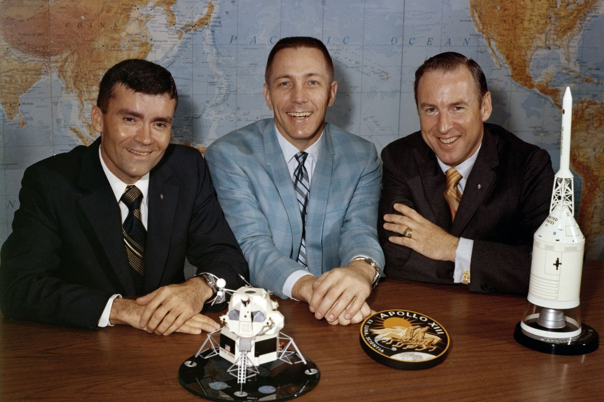 In this April 10, 1970, photo, Apollo 13 astronauts, from left, Fred Haise, Jack Swigert and Jim Lovell gather for a photo on the day before launch.
