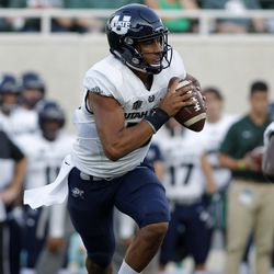 Utah State quarterback Jordan Love rolls out against Michigan State during the first quarter of an NCAA college football game, Friday, Aug. 31, 2018, in East Lansing, Mich.